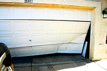 Broken garage door needing repair by Semper Fidelis Garage Doors.