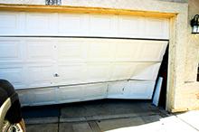 Broken garage door needing repair by Semper Fidelis Garage Doors.